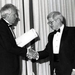 Tomas Tranströmer (left) receiving the Neustadt Prize certificate in June 1990.